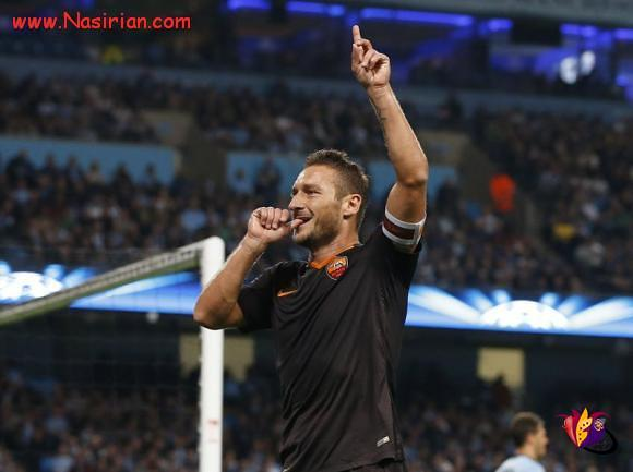 AS Roma's Totti celebrates scoring a goal against Manchester City during their Champions League soccer match at the Etihad Stadium in Manchester